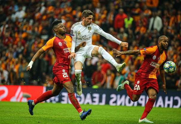 Slide 14 of 75: ISTANBUL, TURKEY - OCTOBER 22: Ryan Donk (15) of Galatasaray and Federico Valverde (C) of Real Madrid vie for the ball during the UEFA Champions League Group A match between Galatasaray and Real Madrid at Turk Telekom Stadium in Istanbul, Turkey on October 22, 2019.  (Photo by )