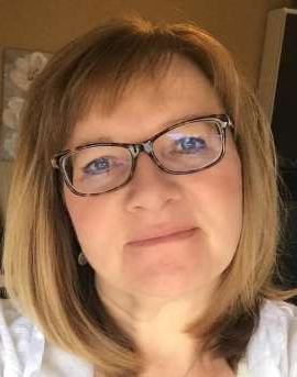 a close up of a woman wearing glasses: Police have found a body that is believed to be Stephanie Hodgson, 49, who was last seen at about 5:30 p.m. on Friday at the CrossIron Mills shopping centre.