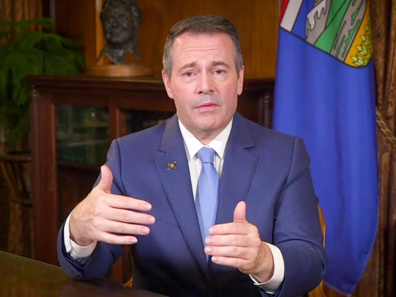 Jason Kenney wearing a suit and tie: Alberta Premier Jason Kenney speaks during a televised address to Albertans before the release of the provincial budget, Oct. 23, 2019.