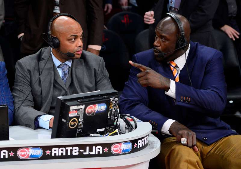 Shaquille O'Neal, Charles Barkley sitting in a chair talking on a cell phone: Shaquille O'Neal and Charles Barkley during the 2013 slam dunk contest.