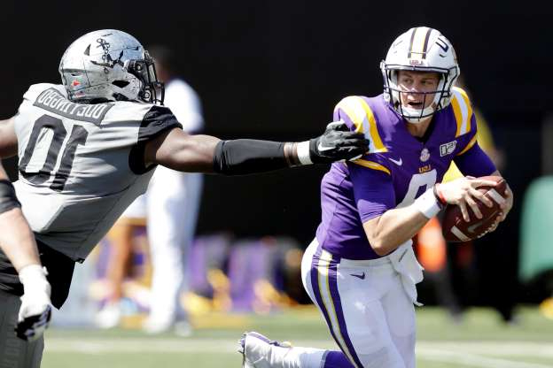 Slide 1 of 128: LSU quarterback Joe Burrow, left, scrambles away from Vanderbilt defensive lineman Dayo Odeyingbo (10) in the first half of an NCAA college football game Saturday, Sept. 21, 2019, in Nashville, Tenn. (AP Photo/Mark Humphrey)