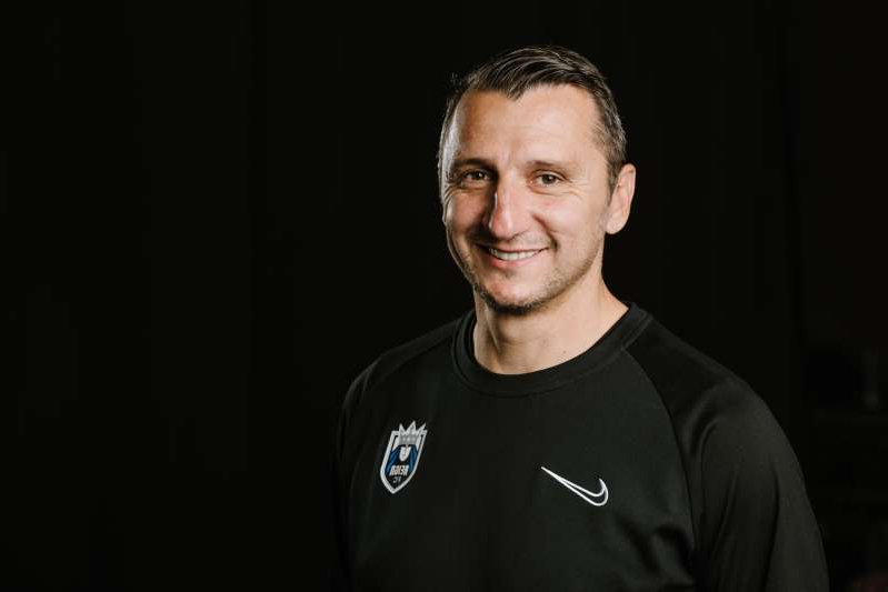 Vlatko Andonovski wearing a black shirt: Vlatko Andonovski is expected to leave his position as Reign FC coach and take over the USWNT. (Getty Images)