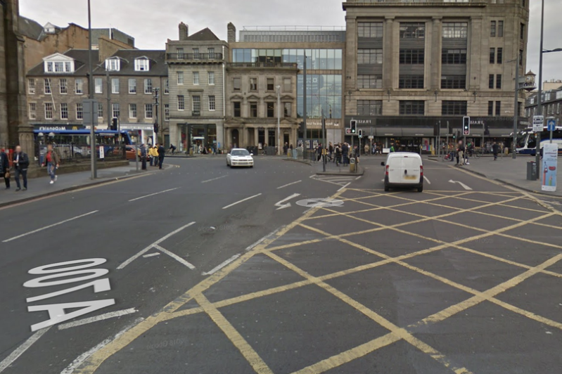 a close up of a busy city street: Emergency services were called to the scene of the incident near The Caledonian Hotel