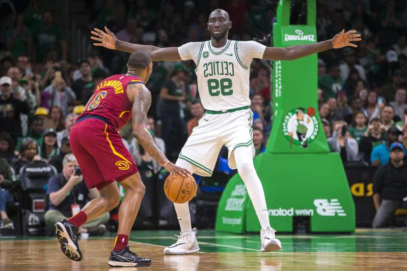 a close up of a man playing a game of basketball: BOSTON - OCTOBER 13: Boston Celtics center Tacko Fall (99) covers Cleveland Cavaliers guard Sindarius Thornwell (3) during the fourth quarter. The Boston Celtics host the Cleveland Cavaliers in a pre-season NBA basketball game at TD Garden in Boston on Oct. 13, 2019. (Photo by Nic Antaya for The Boston Globe via Getty Images)