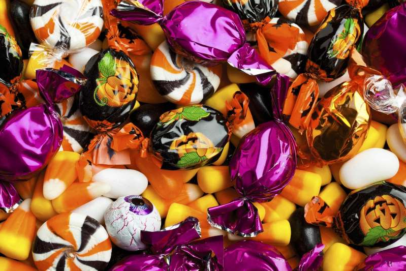 a close up of many different types of food: This is the most hated Halloween candy in America