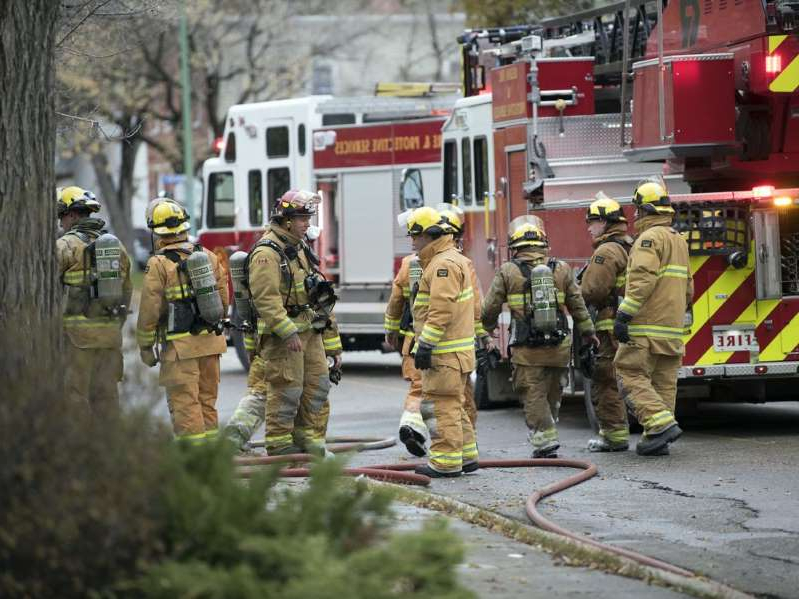 a group of people in uniform:  Regina Fire & Protective Services were on the scene of an early morning house fire at 2276 Rae Street in Regina. Five units first responded to the call around 7 a.m. Tuesday, Oct. 15 and had the fire under control by 8:45 a.m.
