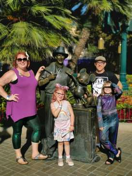a group of people posing for the camera: Brad and Keirsten Benroth with their two daughters Katelyn, left, and Brianna, right, during their vacation to Disneyland in October. Keirsten said the family's Regina home was broken into and set on fire while they were on vacation. (Photo courtesy of Keirsten Benroth)