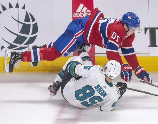 a hockey game in the snow: Montreal Canadiens defenseman Cale Fleury (20) knocks over San Jose Sharks right wing Timo Meier (28) during the third period of an NHL hockey game Thursday, Oct. 24, 2019, in Montreal. (Ryan Remiorz/The Canadian Press via AP)