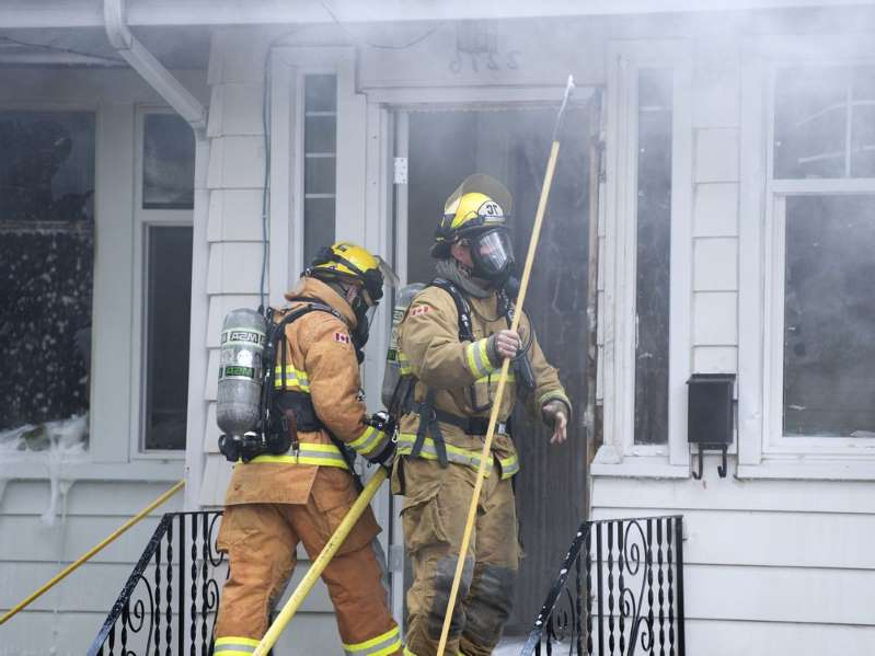a man wearing a yellow hat:  Regina Fire & Protective Services were on the scene of an early morning house fire at 2276 Rae Street in Regina. Five units first responded to the call around 7 a.m. Tuesday, Oct. 15 and had the fire under control by 8:45 a.m.