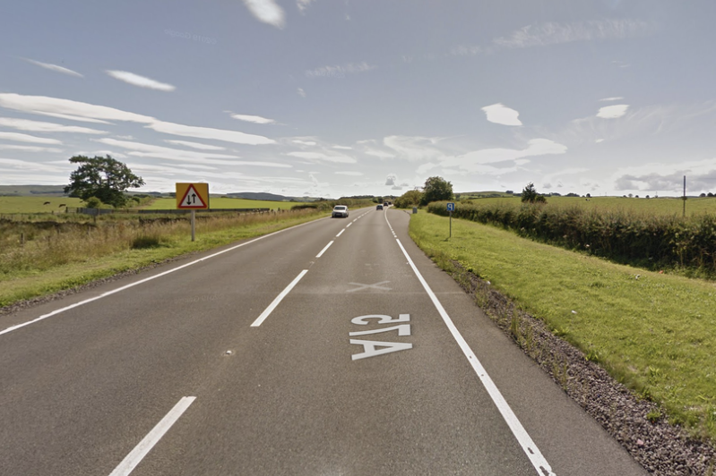 a sign on the side of a road: The car crash took place on the A75 near Lochfoot in south-west Scotland