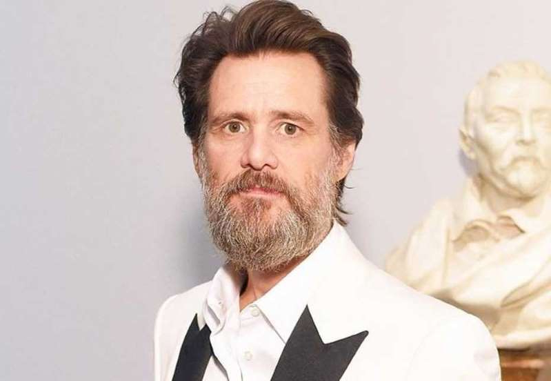 Jim Carrey wearing a suit and tie