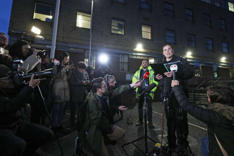 a group of people standing in front of a crowd posing for the camera: Deputy Chief Constable Pippa Mills speaks to the media (Yui Mok/PA)