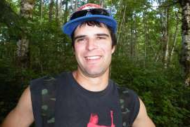 a man wearing a hat and smiling at the camera: Sam Fitzpatrick, 24, was killed by a falling boulder on a Kiewit Corporation worksite in B.C.'s Toba Inlet on Feb. 22, 2009.