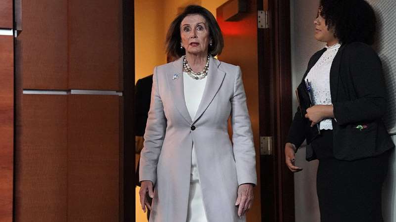 Nancy Pelosi standing in front of a mirror posing for the camera: Pelosi: Court ruling 'another blow' to President Trump