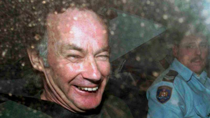 a man smiling for the camera: Australian serial killer Ivan Milat, pictured (left) in 1997, has died of cancer