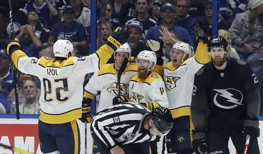 Nashville Predators defenseman Ryan Ellis (4) celebrates his goal against the Tampa Bay Lightning with teammates, including defenseman Roman Josi (59) during overtime of an NHL hockey game Saturday, Oct. 26, 2019, in Tampa, Fla. (AP Photo/Chris O'Meara)