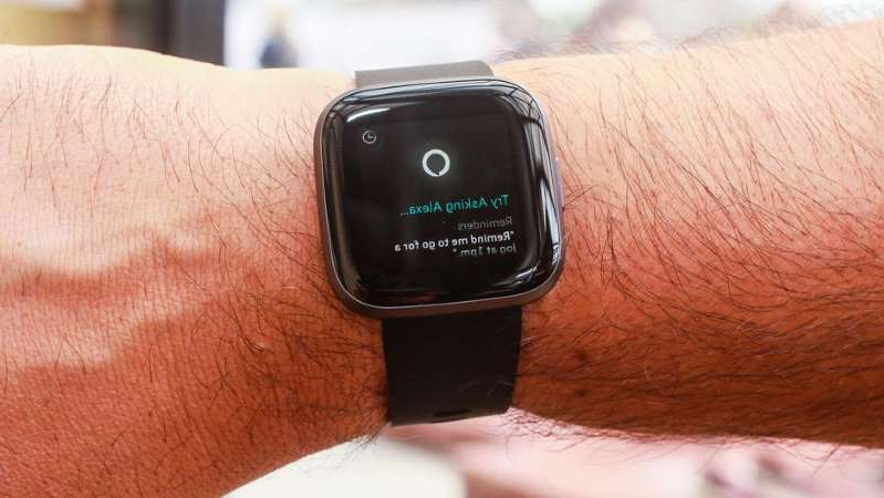 a close up of a cell phone: Google-parent Alphabet may be eyeing Fitbit, makers of the Versa 2 smartwatch. Sarah Tew/CNET