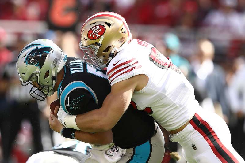 a person wearing a costume: Nick Bosa (97) of the San Francisco 49ers sacks Kyle Allen (7) of the Carolina Panthers during the first quarter on Sunday, Oct. 27, 2019 at Levi's Stadium in Santa Clara, Calif.