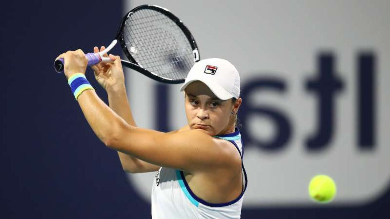 Ashleigh Barty hitting a ball with a racket