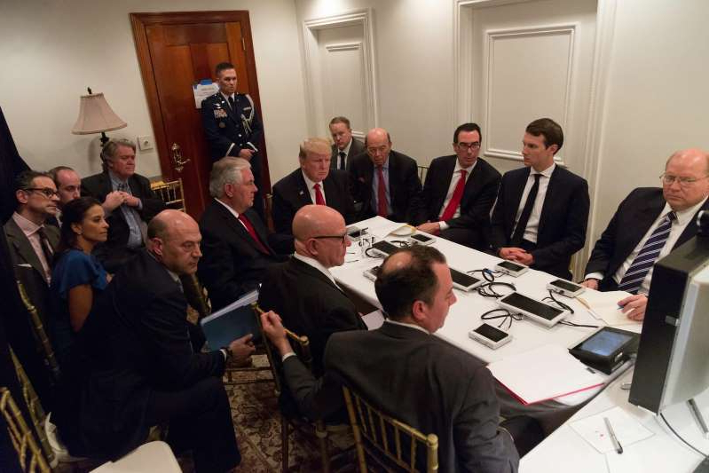 Joe Hagin, Steven Mnuchin, Wilbur Ross, Gary Cohn, Stephen K. Bannon sitting at a table with wine glasses
