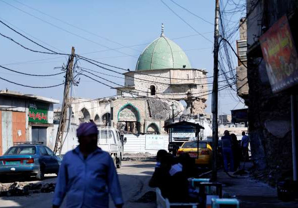 Slide 5 of 9: A man walks near of al-Nouri damaged mosque,  where Islamic State leader Abu Bakr al-Baghdadi declared his caliphate back in 2014, in the old city of Mosul, Iraq, October 27, 2019.