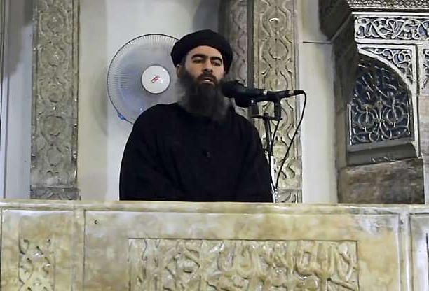 Slide 9 of 9: An image grab taken from a video released on July 5, 2014 shows Alleged Islamic State of Iraq and the Levant (ISIL) leader Abu Bakr al-Baghdadi preaching during Friday prayer at a mosque in Mosul.