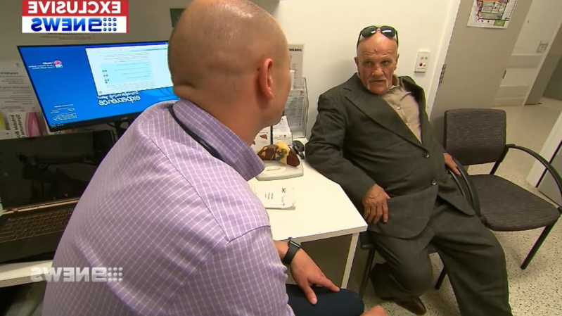 a man sitting at a desk: Mr Hart was diagnosed with liver cancer and started treatment at the hospital.