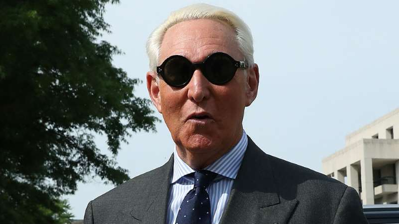 a man wearing a suit and sunglasses: Roger Stone's defense fund has a goal of $3 million.