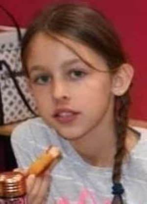 a woman smiling for the camera: The bodies of Mia Djurasovic (pictured), 10, and six-year-old Tiana were found by their father Nenad at their Madeley home on Friday evening