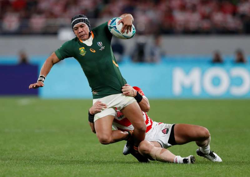 Cheslin Kolbe holding a football ball on a field: Rugby World Cup 2019 - Quarter Final - Japan v South Africa