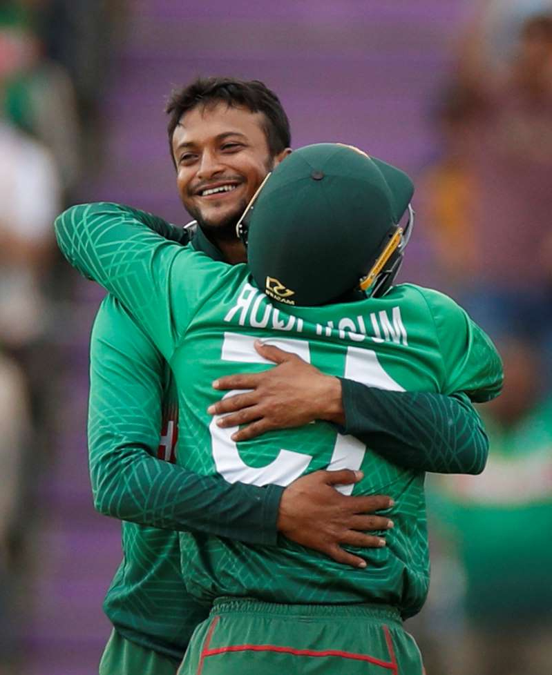 Cricket - ICC Cricket World Cup - Bangladesh v Afghanistan - The Ageas Bowl, Southampton, Britain - June 24, 2019   Bangladesh's Shakib Al Hasan and Mushfiqur Rahim celebrate taking the wicket of Afghanistan's Najibullah Zadran   Action Images via Reuters/John Sibley