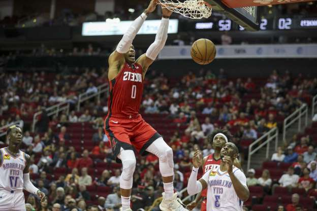 Slide 1 of 21: Houston Rockets guard Russell Westbrook (0) gets a basket as Oklahoma City Thunder guard Chris Paul (3) looks on during the second quarter of an NBA basketball game at the Toyota Center on Monday, Oct. 28, 2019, in Houston.