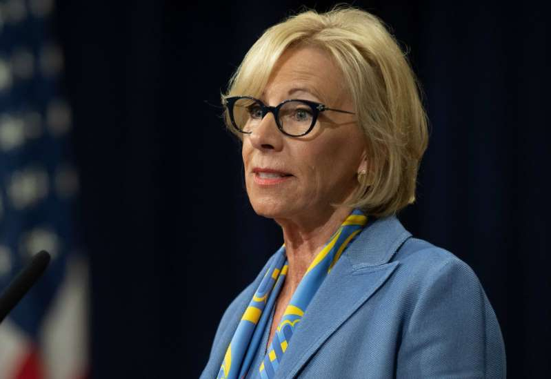Betsy DeVos wearing glasses: US Secretary of Education Betsy DeVos speaks during the Summit on Combating Anti-Semitism at the Department of Justice in Washington, DC, July 15, 2019. (Photo by SAUL LOEB / AFP) (Photo credit should read SAUL LOEB/AFP/Getty Images)
