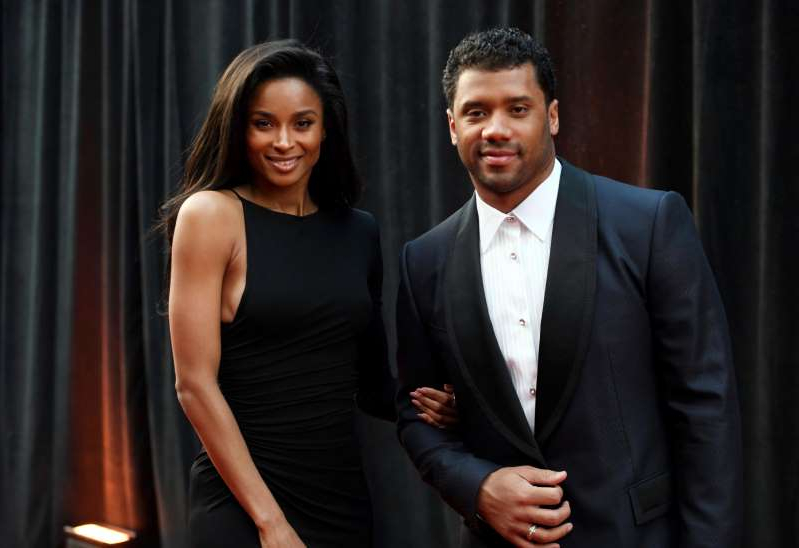 Russell Wilson, Ciara are posing for a picture: Ciara and Russell Wilson dress up as Beyonce and Jay-Z for Halloween.