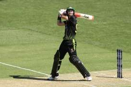a baseball player holding a bat on a field: Glenn Maxwell will take a break from cricket.