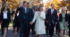 a group of people standing in a suit and tie: Justin Trudeau and his wife Sophie Trudeau-Gregoire arrive at Rideau Hall with his future cabinet to take part in a swearing-in ceremony in Ottawa on Wednesday, November 4, 2015.