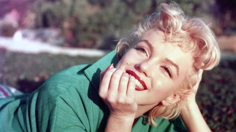a person talking on a cell phone: Marilyn Monroe's image continues to make big money for her estate