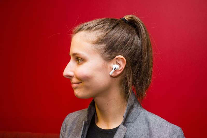 a person wearing glasses and looking at the camera: AirPods Pro, of course, are supported. Sarah Tew/CNET