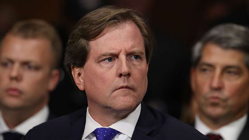 Don McGahn wearing a suit and tie: Democrats ask judge to force McGahn to comply with subpoena