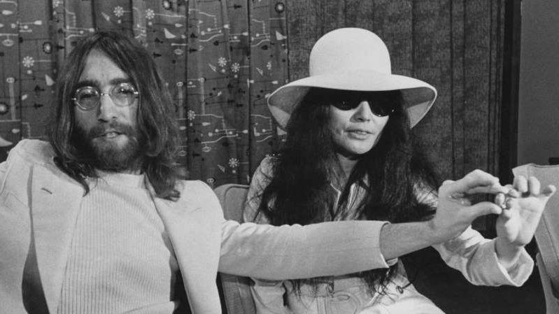 John Lennon et al. wearing a hat: Lennon was shot dead in 1980 but he continues to make millions