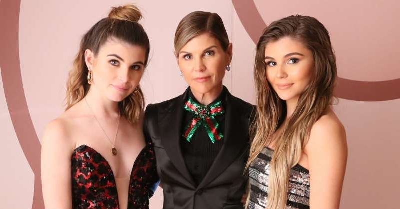 Lori Loughlin et al. posing for a picture: Former Federal Prosecutor Says Lori Loughlin's Daughters Could Be Charged in College Scandal