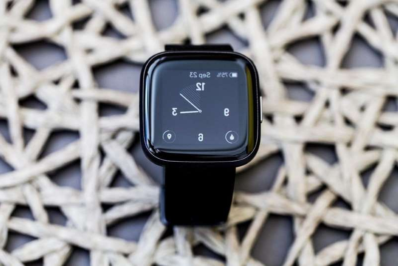 a black watch on a white background: Fitbit is the company behind the Versa 2 smartwatch. Angela Lang/CNET