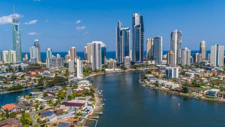 a body of water with Panama City in the background: A man was allegedly attacked at a Surfers Paradise park on the Gold Coast.