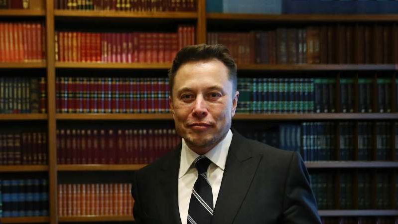 Elon Musk wearing a suit and tie: Image: Getty Images