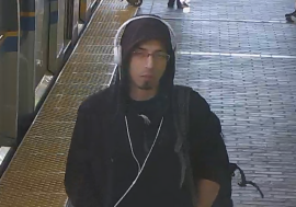 a person standing in front of a subway: A surveillance photo of the suspect in an April 29, 2019 indecent exposure incident on SkyTrain.