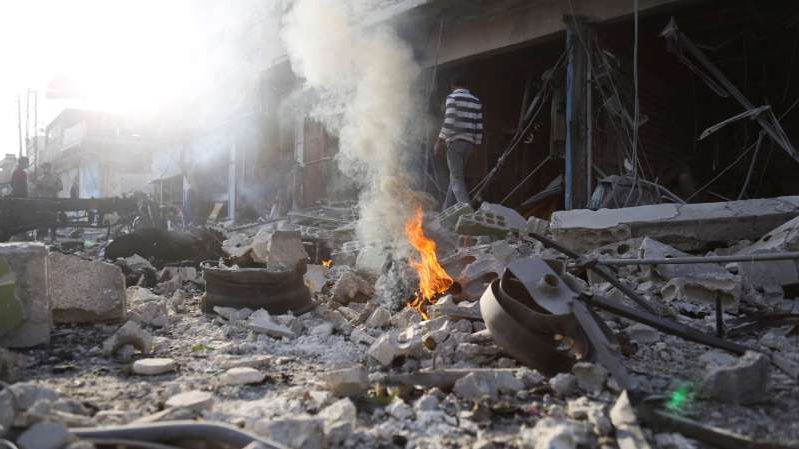 a pile of smoke: The incident occurred in the northern Syrian town of Tal Abyad (AP)