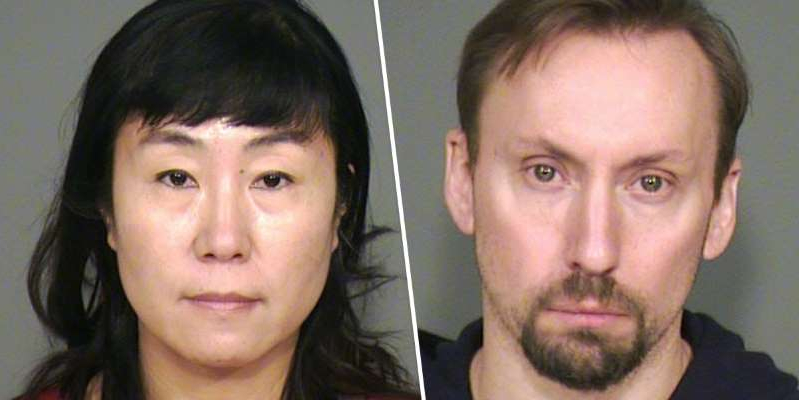 a man and a woman looking at the camera: Zach Robbins and his wife Jie Robbins were arrested for trafficking stolen property.