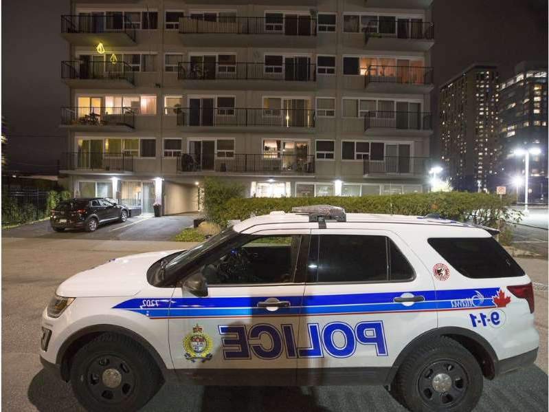 a police car parked in front of a building: An Ottawa police vehicle sat outside the Sidney Towers on Sidney Street on  Friday.