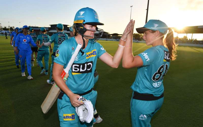 Jessica Jonassen (right) of the Heat celebrates with Amelia Kerr (left) after winning the WBBL Cricket match between Brisbane Heat and Adelaide Strikers.