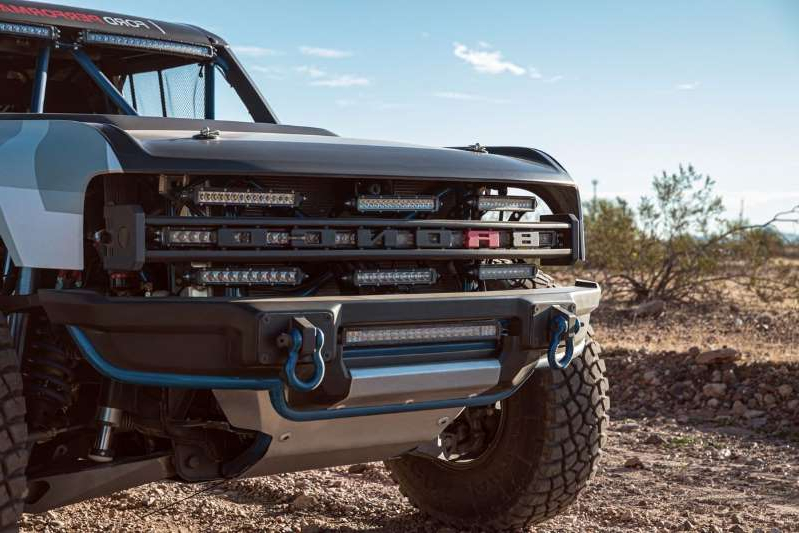 a black truck sitting on top of a dirt field: 2020 Ford Bronco Off Road Sema edition